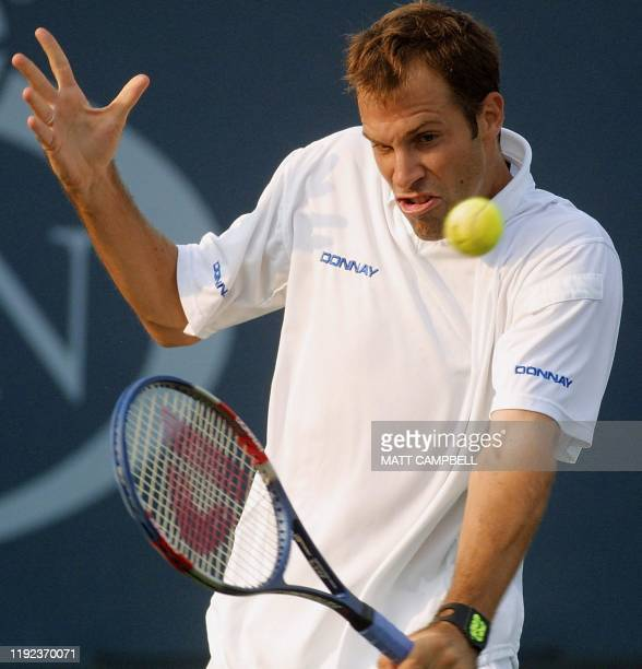 Greg Rusedski of Great Britain backhands a volley to Jonas Bjorkman of Sweden during their second round match of the US Open at Flushing Meadows, New...