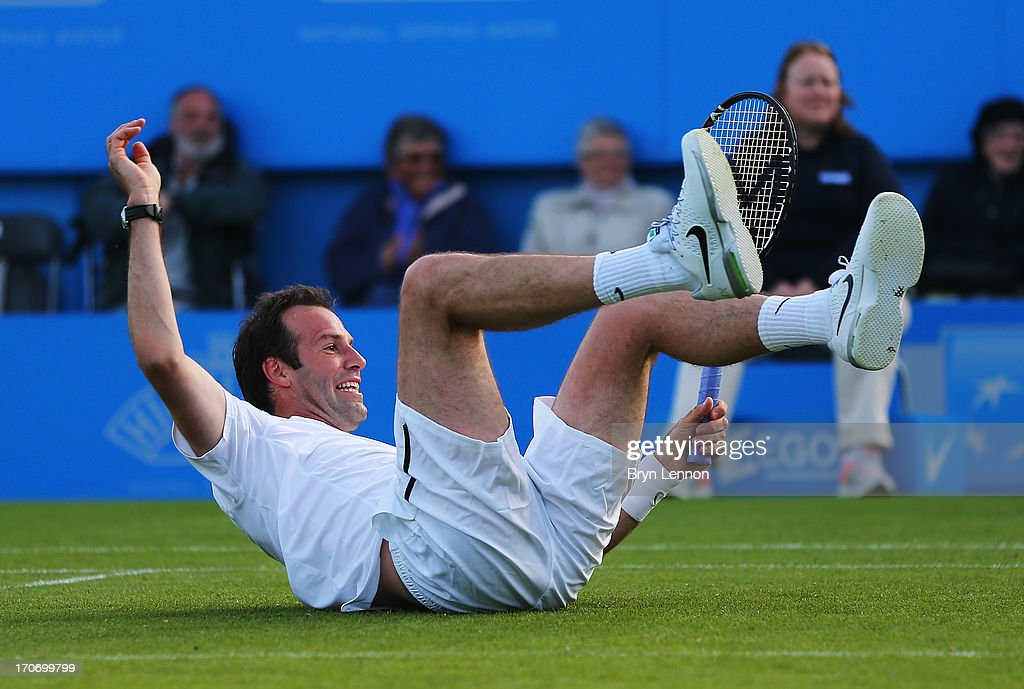 Greg Rusedski of Great Britain falls to the ground partnering Lindsay Davenport of USA in their mixed doubles exhibition legends match against Mark Philippoussis and Rennae Stubbs of Australia during day two of the AEGON International tennis tournament at Devonshire Park on June 16, 2013 in Eastbourne, England.