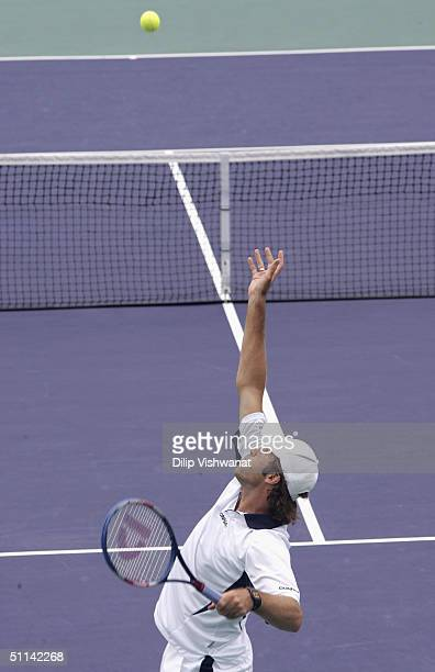 Greg Rusedski of Great Britain serves to Gaston Gaudio of Spain during the Western and Southern Financial Group Masters tournament August 4 2004 at...