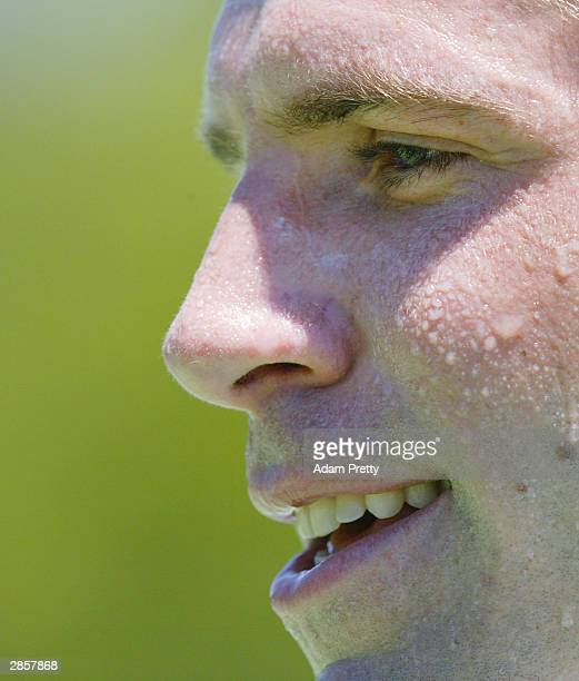Greg Rusedski of Great Britain sweats it out during warm up for the Adidas International at Sydney International Tennis Centre on January 11, 2004 in...