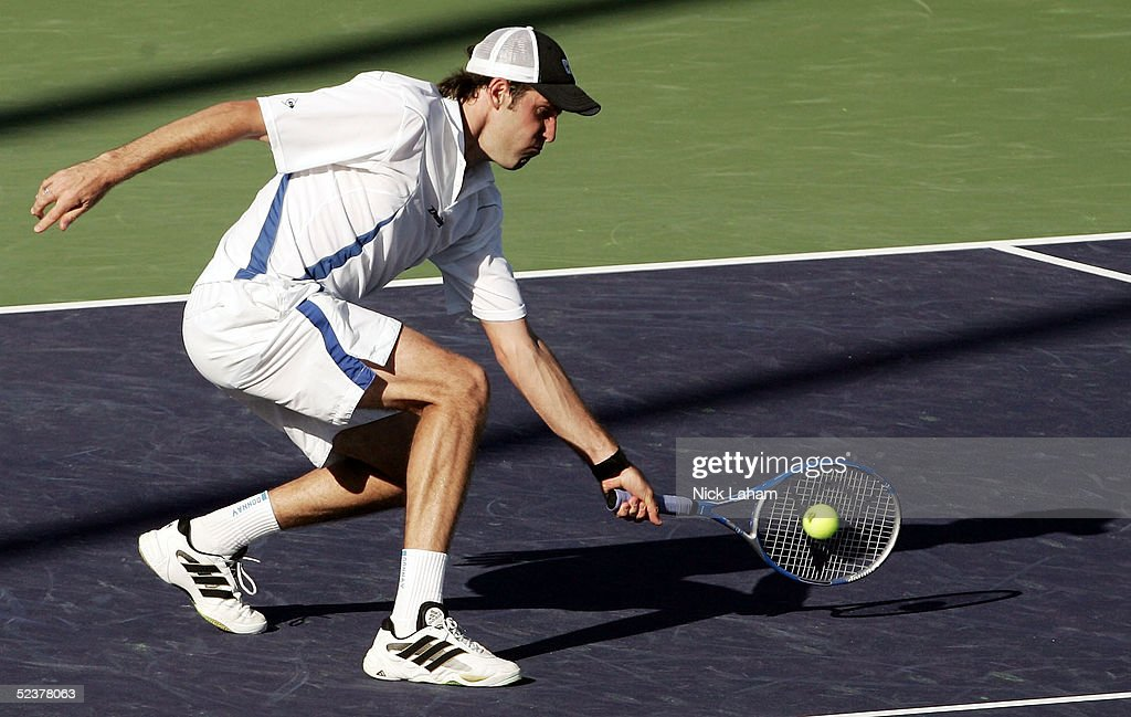 Greg Rusedski of Great Britain volleys in his match against Jeff Salzenstein of the United States during the Pacific Life Open at the Indian Wells Tennis Garden on March 11, 2005 in Indian Wells, California.