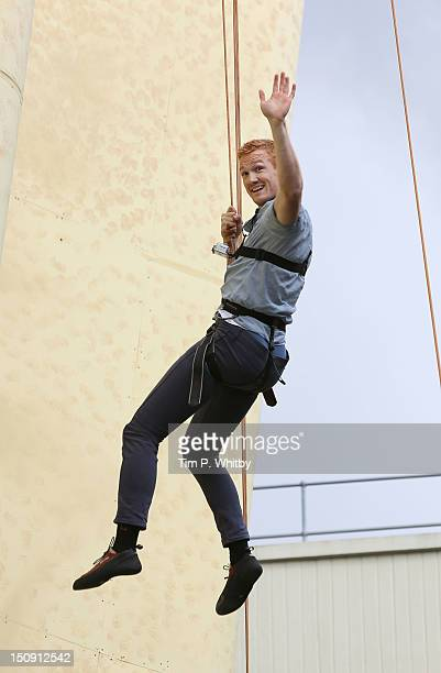 Greg Rutherford attends the launch of Walkers Deep Ridged crisp at The Old Truman Brewery on August 29 2012 in London England
