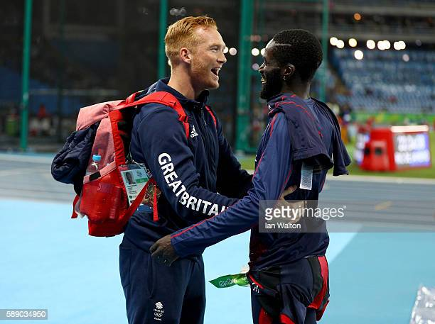 Greg Rutherford of Great Britain and Kafetien Gomis of France in discussion after the Men's Long Jump Qualifying Round on Day 7 of the Rio 2016...