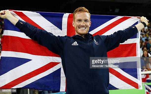 Greg Rutherford of Great Britain celebrates after the Men's Long Jump Final on Day 8 of the Rio 2016 Olympic Games at the Olympic Stadium on August...