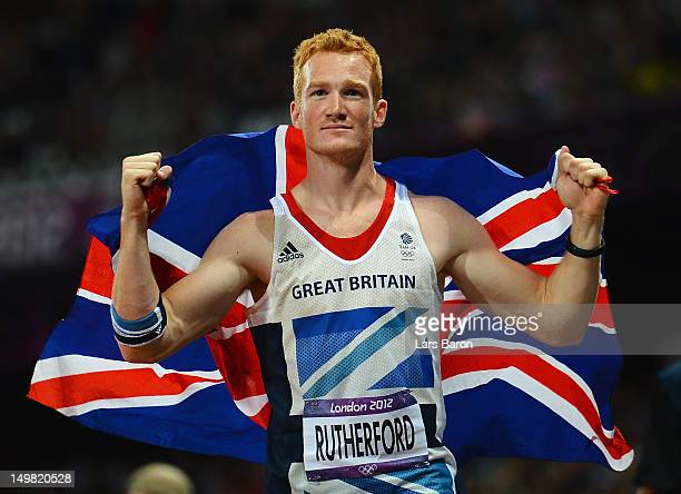 Greg Rutherford of Great Britain celebrates winning gold in the Men's Long Jump Final on Day 8 of the London 2012 Olympic Games at Olympic Stadium on...