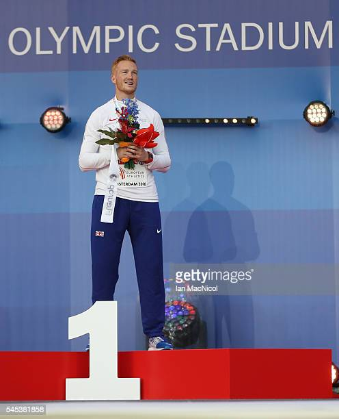 Greg Rutherford of Great Britain poses with his medal from the Men's Long Jump during Day Two of The European Athletics Championships at Olympic...