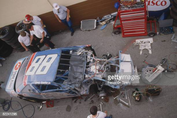 Greg Sacks' Crisco car is torn down after an accident during the Daytona 500 at the Daytona Speedway on February 19 1989 in Daytona Beach Florida