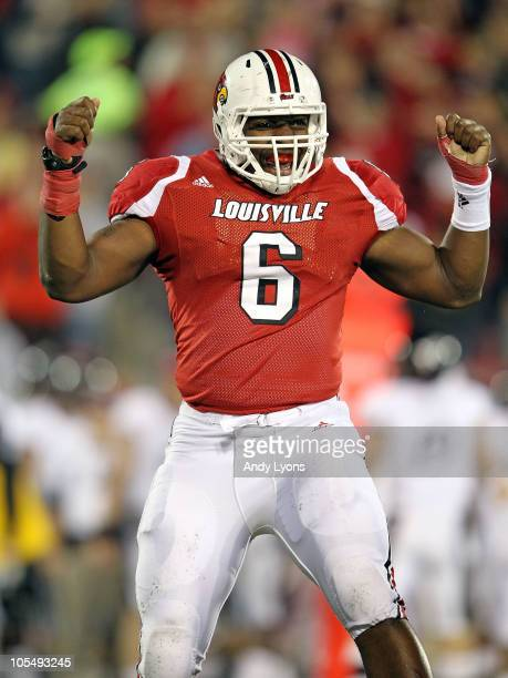 Greg Scruggs of the Louisville Cardinals celebrates after intercepting a pass during the Big East Conference game against the Cincinnati Bearcats at...