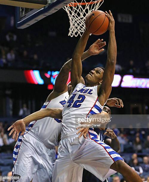 Greg Sequele of the DePaul Blue Demons rebounds against the Villanova Wildcats at the Allstate Arena on February 12 2014 in Rosemont Illinois...