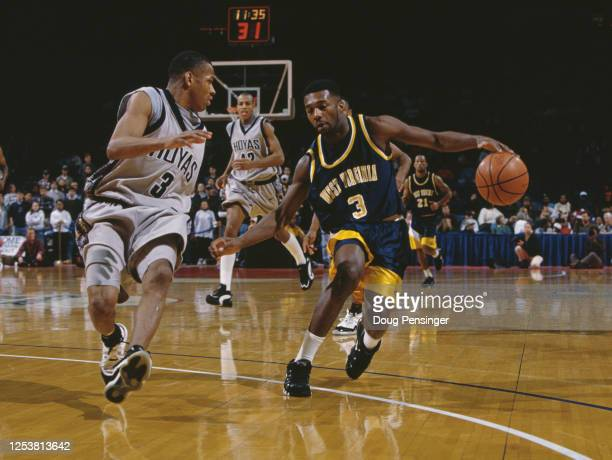 Greg Simpson, Guard for the University of West Virginia Mountaineers and Allen Iverson of the Georgetown University Hoyas during their NCAA Big East...