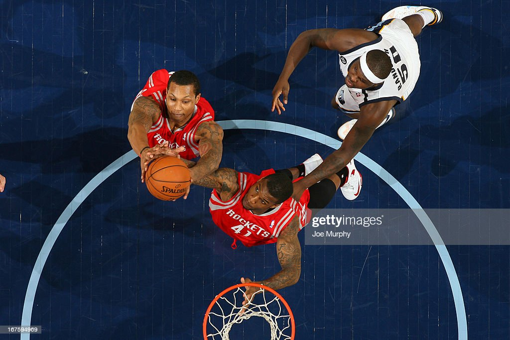 Greg Smith #4 and Thomas Robinson #41 of the Houston Rockets go up for a rebound against Zach Randolph #50 of the Memphis Grizzlies on March 29, 2013 at FedExForum in Memphis, Tennessee.