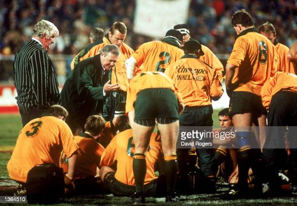 Greg Smith coach of the Australian Wallabies addresses his team at half time during the Tri Nations match played between the South African Springboks...