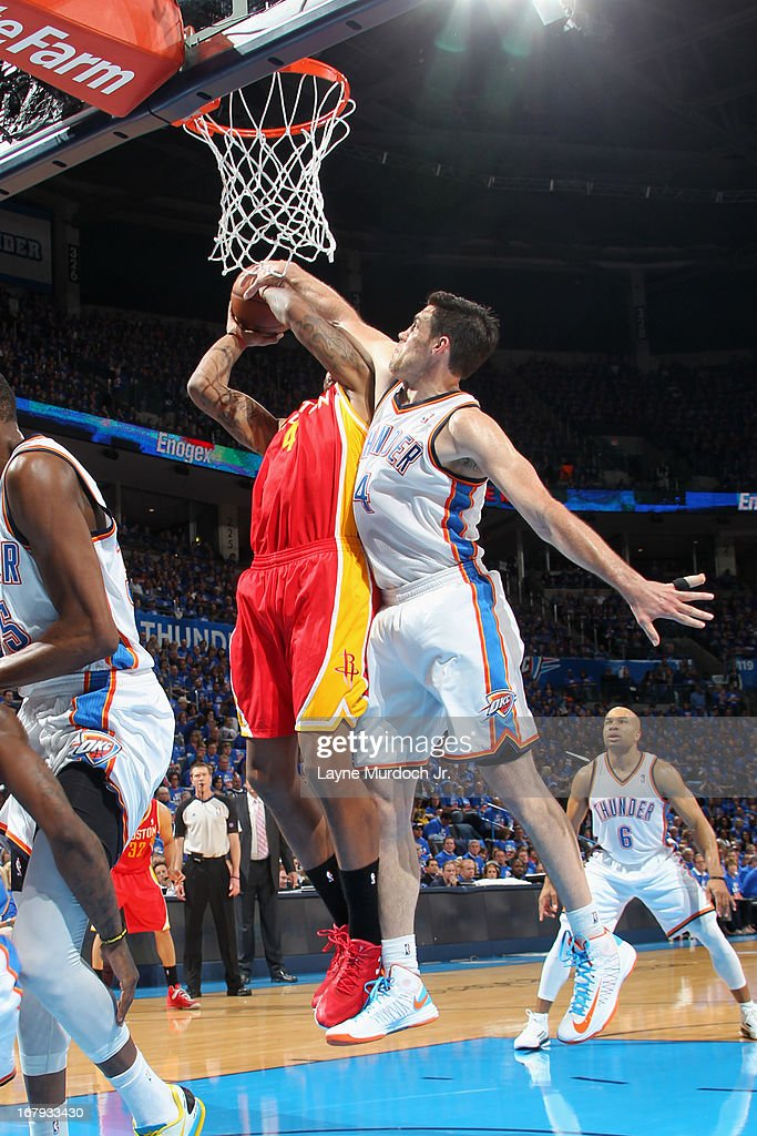 Greg Smith #4 of the Houston Rockets drives to the basket and gets his shot blocked by Nick Collison #4 of the Oklahoma City Thunder in Game Five of the Western Conference Quarterfinals during the 2013 NBA Playoffs on May 1, 2013 at the Chesapeake Energy Arena in Oklahoma City, Oklahoma.