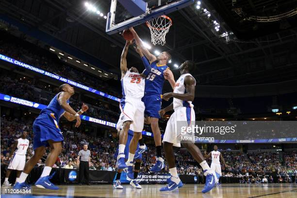 Greg Somogyi of the UC Santa Barbara Gauchos blocks a shot attempt by Alex Tyus of the Florida Gators during the second round of the 2011 NCAA men's...