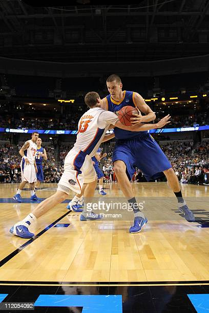 Greg Somogyi of the UC Santa Barbara Gauchos drives against Erik Murphy of the Florida Gators during the second round of the 2011 NCAA men's...