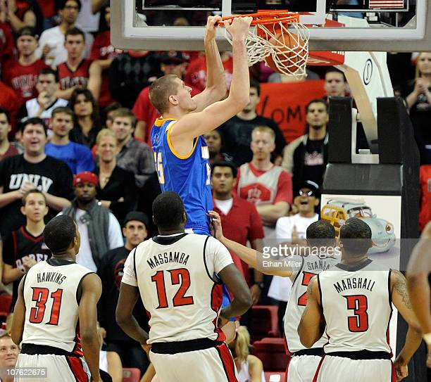 Greg Somogyi of the UC Santa Barbara Gauchos dunks in front of Justin Hawkins Brice Massamba Chace Stanback and Anthony Marshall of the UNLV Rebels...
