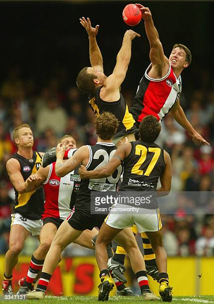 Greg Stafford for Richmond and Jason Blake for St Kilda in action during the round three AFL match between the St Kilda Saints and Richmond Tigers on...