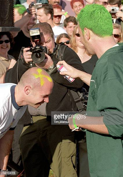 Greg Sterling paints an XP on Tom Yaryan''s head as they wait for Microsoft Chairman and Chief Software Architect Bill Gates to announce the release...