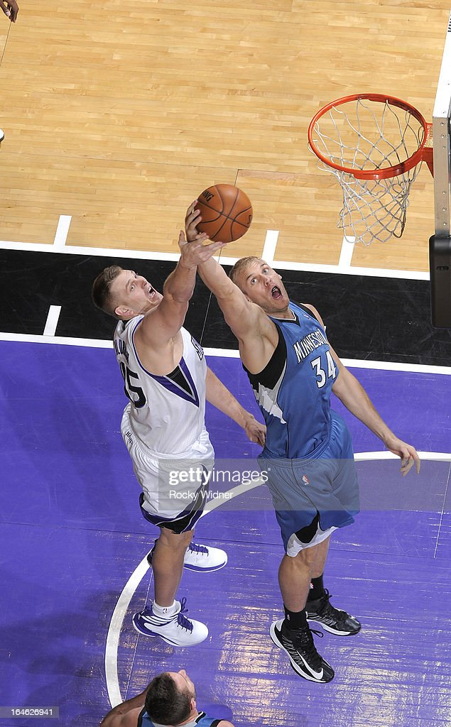 Greg Stiemsma #34 of the Minnesota Timberwolves and Cole Aldrich #45 of the Sacramento Kings go up for the rebound on March 21, 2013 at Sleep Train Arena in Sacramento, California.