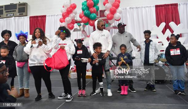 Greg Street Tia Wilburn Londyn Wilburn Stephanie Jester Future Zahir Wilburn and Rapper Future attend Free Wishes Foundation Interactive Winter...
