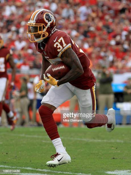 Greg Stroman of the Washington Redskins rushes after an interception during a game against the Tampa Bay Buccaneers at Raymond James Stadium on...