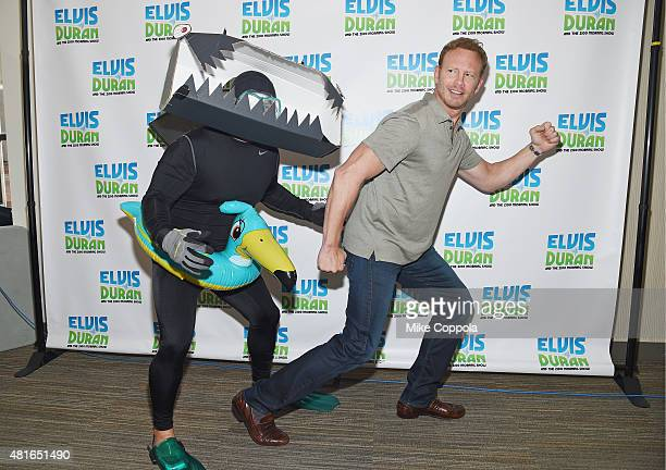 Greg T chases actor Ian Ziering as he visits The Elvis Duran Z100 Morning Showat Z100 Studio on July 23 2015 in New York City