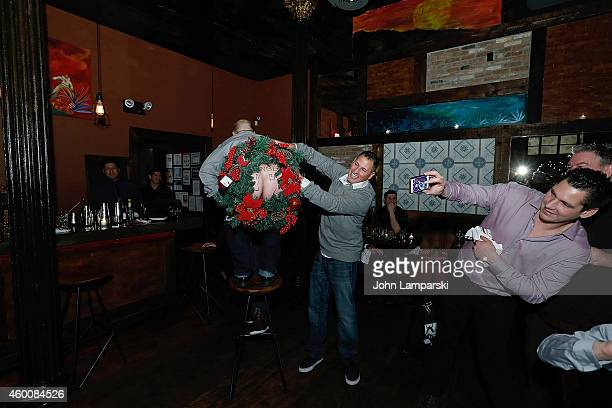 Greg T Scott Bodin and Alex Carr attend Elvis Duran Z100 Morning Show Holiday Party at Anejo Tribeca on December 6 2014 in New York City
