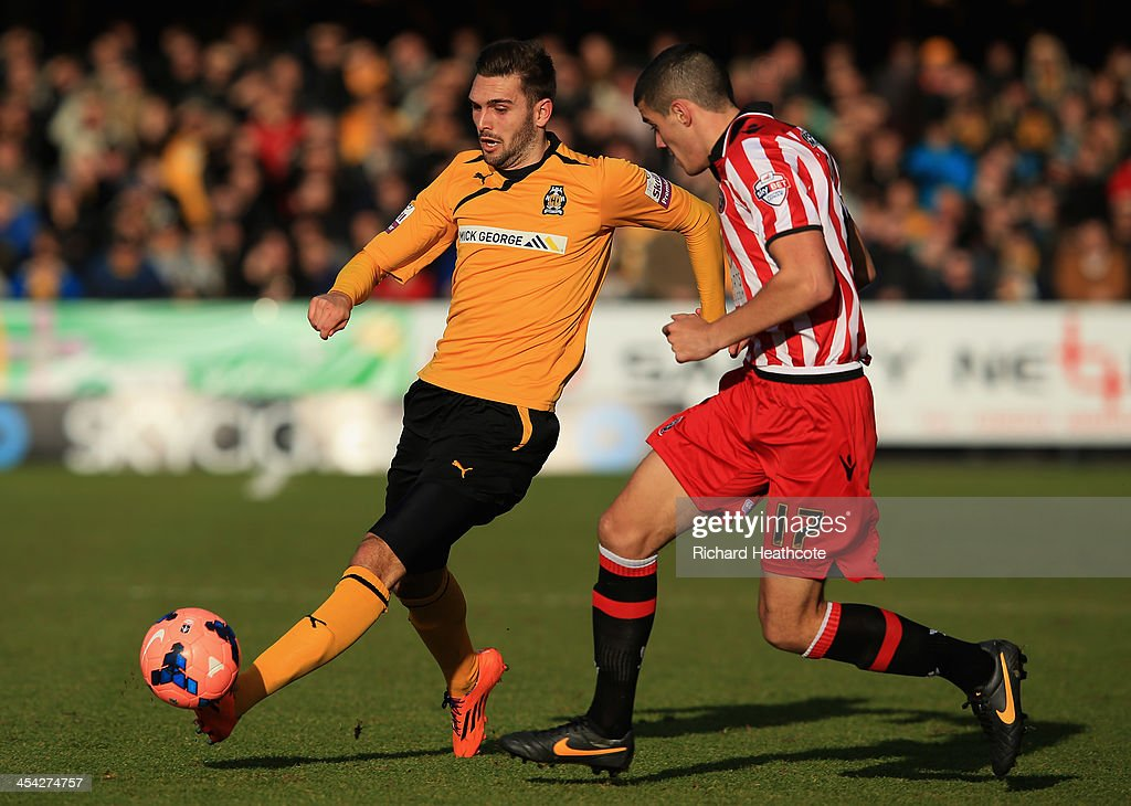 Greg Taylor of Cambridge goes past Conor Coady of Sheffield during the FA Cup Second Round match between Cambridge United and Sheffield United at the Abbey Stadium on December 8, 2013 in Cambridge, Cambridgeshire.