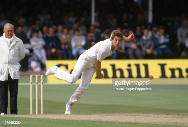 Greg Thomas bowling for England during the 2nd Test match between England and New Zealand at Trent Bridge Nottingham 8th August 1986 The umpire is...