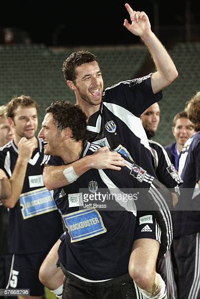 Greg Uhlmann gives Riki van Steeden of Auckland City FC a piggyback as they celebrate the team winning the OFC Club Championship Final match between...