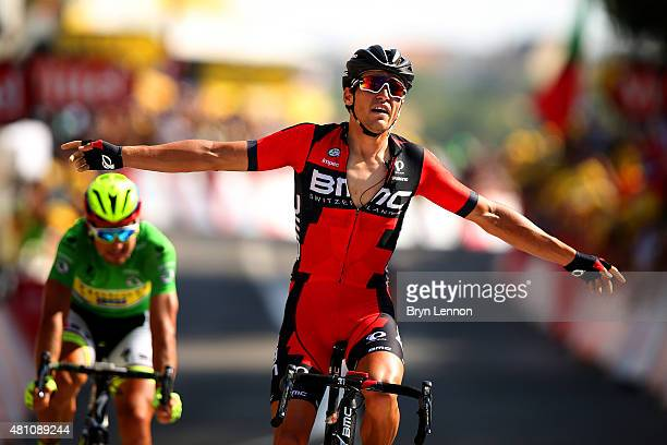 Greg van Avermaet of Belgium and BMC Racing Team celebrates as he crosses the finish line ahead of Peter Sagan of Slovakia and Tinkoff-Saxo during...