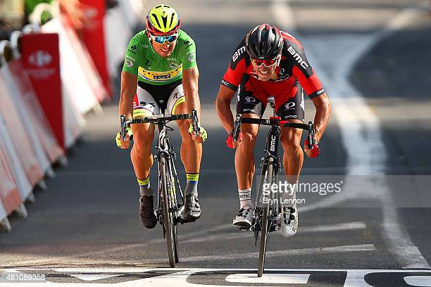 Greg van Avermaet of Belgium and BMC Racing Team crosses the finish line ahead of Peter Sagan of Slovakia and Tinkoff-Saxo during stage thirteen of...