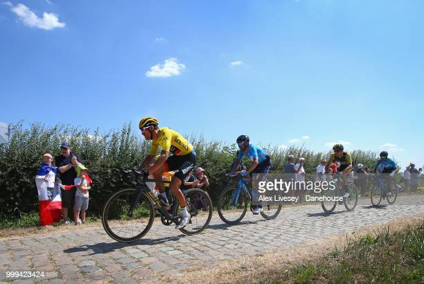 Greg Van Avermaet of Belgium and BMC Racing Team is seen in action wearing the yellow leader jersey during the cobblestones sector between Tilloy and...