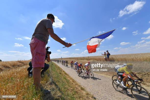 Greg Van Avermaet of Belgium and BMC Racing Team Yellow Leader Jersey / Peloton / Cobbles / Pave / Fans / Public / French flag / Landscape / during...
