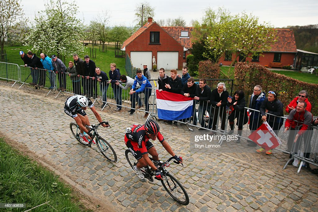 Greg van Avermaet of the BMC Racing Team leads Stijn Vandenbergh of Belgium and the Omega Pharma-QuickStep team at the top of the Kwaremont during the 98th Tour of Flanders from Bruges to Oudenaarde on April 6, 2014 in Oudenaarde, Belgium.