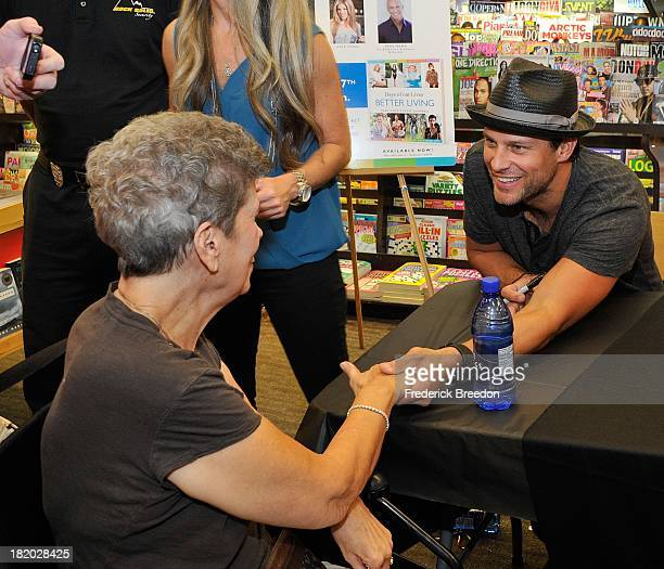 Greg Vaughan greets a fan at the Days of our Lives Better Living book tour on September 27 2013 in Nashville Tennessee
