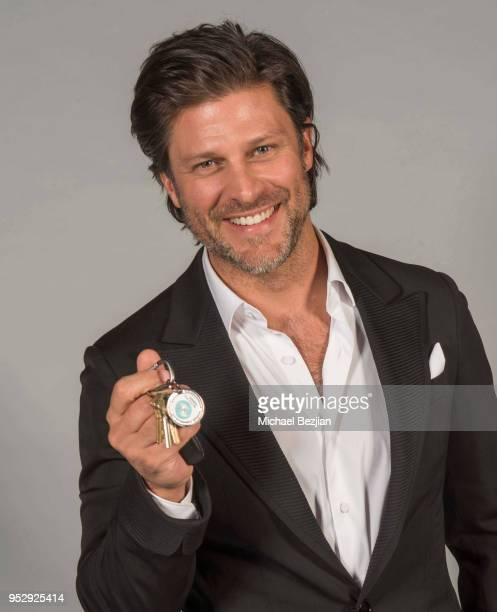 Greg Vaughan poses with TAP medallion at 45th Daytime Emmy Awards Portraits by The Artists Project Sponsored by the Visual Snow Initiative on April...