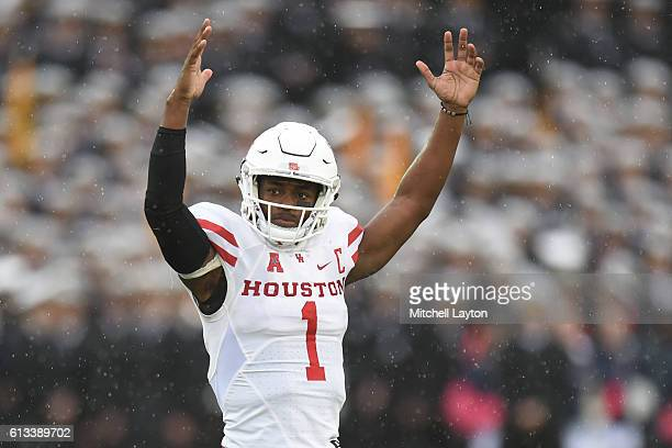 Greg Ward Jr. #1 of the Houston Cougars celebrates teams first touchdown in the first period a football game against the Navy Midshipmen at...