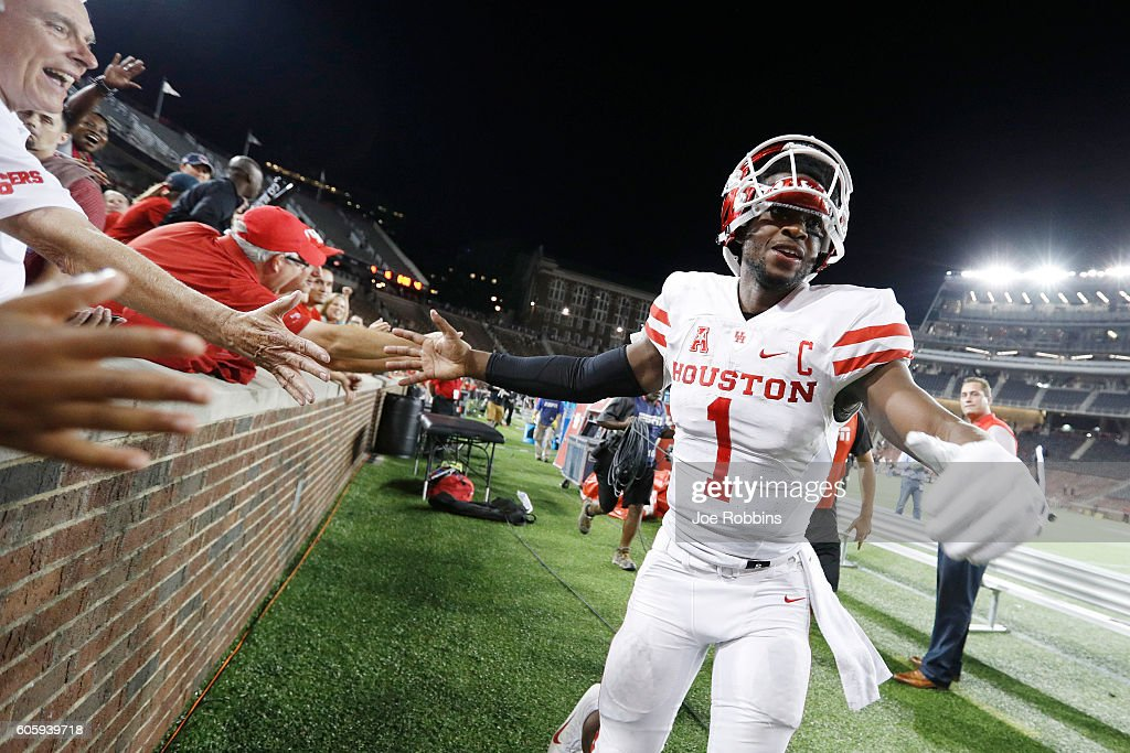 Greg Ward Jr. #1 of the Houston Cougars celebrates with fans after the game against the Cincinnati Bearcats at Nippert Stadium on September 15, 2016 in Cincinnati, Ohio. Houston defeated Cincinnati 40-16.