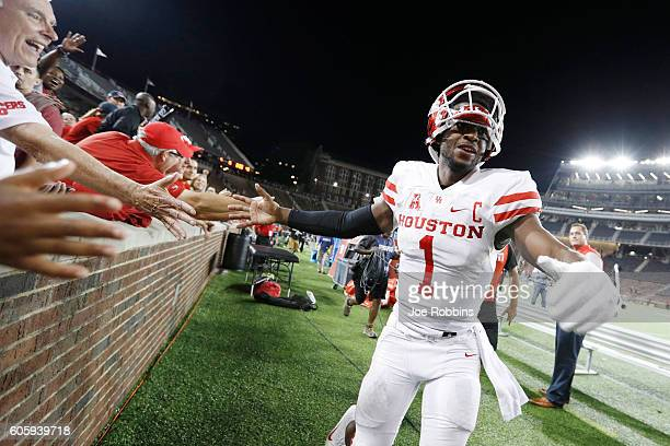 Greg Ward Jr. #1 of the Houston Cougars celebrates with fans after the game against the Cincinnati Bearcats at Nippert Stadium on September 15, 2016...