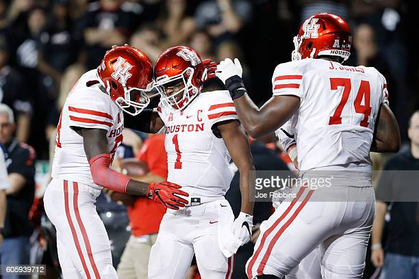 Greg Ward Jr. #1 of the Houston Cougars celebrates with teammates after rushing for a three-yard touchdown in the fourth quarter against the...