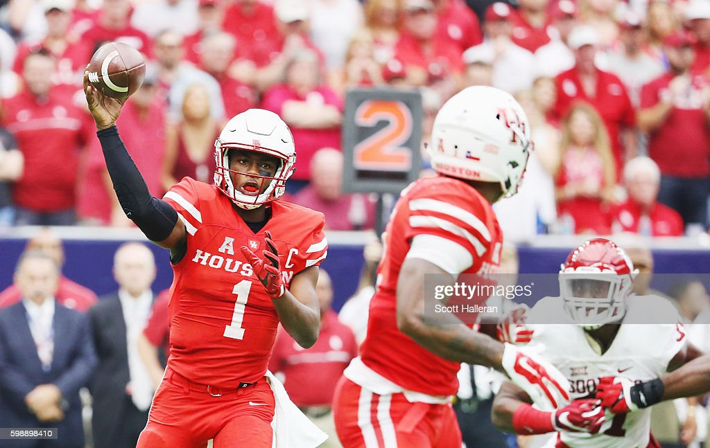 Greg Ward Jr. #1 of the Houston Cougars drops back to pass in the first half of their game against the Oklahoma Sooners during the Advocare Texas Kickoff on September 3, 2016 in Houston, Texas.