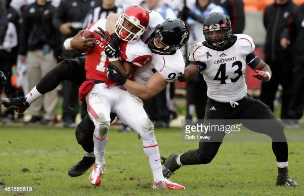 Greg Ward Jr #1 of the Houston Cougars is sacked by Brad Harrah of the Cincinnati Bearcats as Nick Temple watches at BBVA Compass Stadium on November...