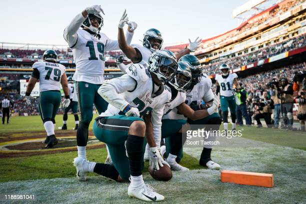 Greg Ward of the Philadelphia Eagles celebrates with teammates after scoring the game-winning touchdown against the Washington Redskins during the...