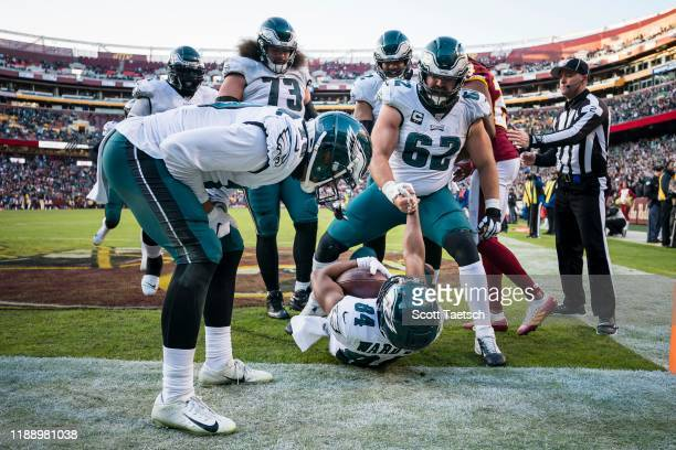 Greg Ward of the Philadelphia Eagles is helped up by Jason Kelce after scoring the game-winning touchdown against the Washington Redskins during the...