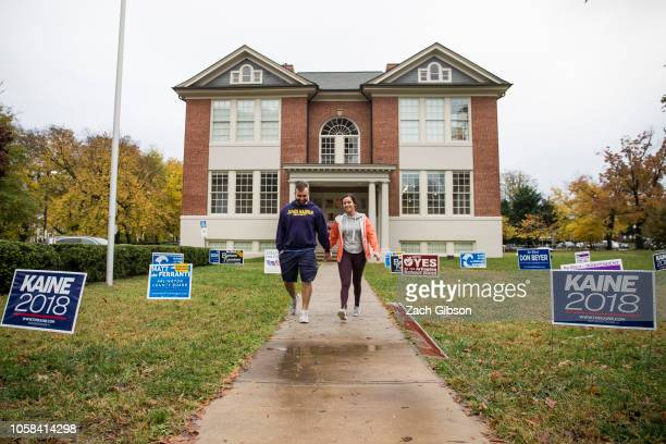 Greg Weisbecker left and Dany Fournier right leave the Arlington Arts Center during the 2018 midterm election on November 6 2018 in Arlington VA...