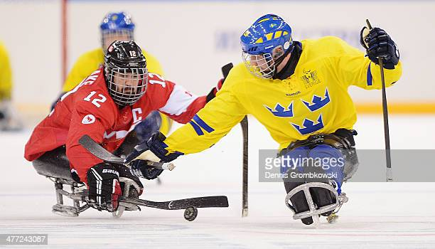 Greg Westlake of Canada and Niklas Rakos of Sweden battle for the puck during the Preliminary Round Group A match between Canada and Sweden at Shayba...