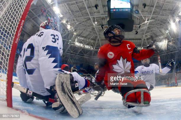 Greg Wetslake of Canada fails to score a goal over Woong Jae Lee goaltender of Korea in the Ice Hockey semi final game between Canada and Korea...