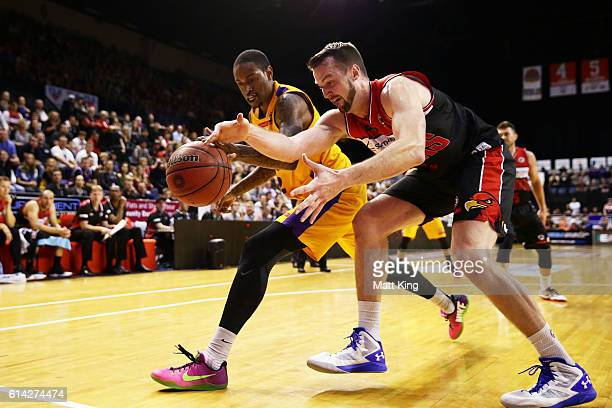 Greg Whittington of the Kings competes for the ball against AJ Ogilvy of the Hawks during the round two NBL match between the Illawarra Hawks and the...