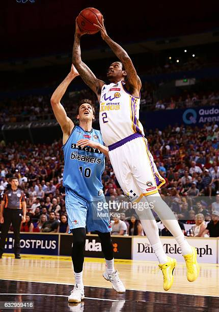 Greg Whittington of the Kings drives to the basket under pressure from Thomas Abercrombie of the Breakers during the round 17 NBL match between the...